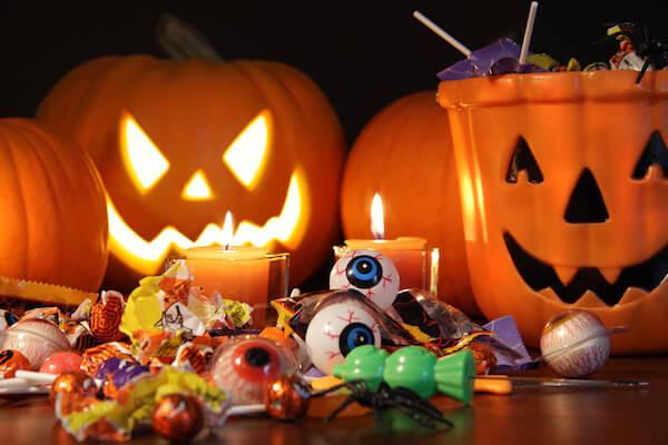 Closeup of candies with pumpkins after Hallowen festivities